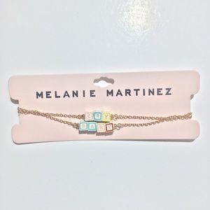"Melanie Martinez ""Cry Baby"" gold necklace."